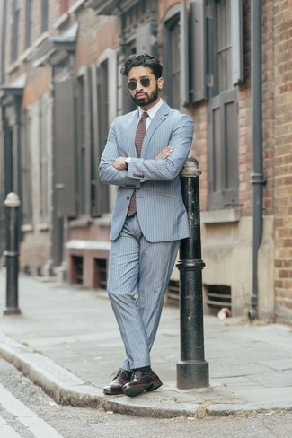 How to Wear a Burgundy Print Tie For Men: Reach for a light blue vertical striped suit and a burgundy print tie to look like a real gentleman with a great deal of class. Dial down the classiness of your getup by finishing with a pair of burgundy leather derby shoes.