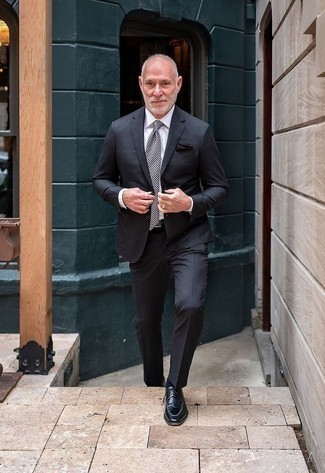 How to Wear a Charcoal Suit: To look like a proper gentleman, team a charcoal suit with a white dress shirt. Go ahead and introduce a pair of black leather derby shoes to the mix for a more relaxed touch.