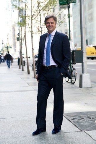 How to Wear a Navy Vertical Striped Suit: This combination of a navy vertical striped suit and a white dress shirt is a never-failing option when you need to look truly dapper and polished. Complement this look with navy suede derby shoes and ta-da: the getup is complete.