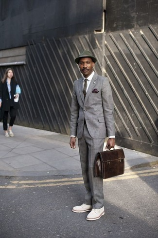 How to Wear a Hat For Men: Want to infuse your menswear arsenal with some fashion-forward cool? Opt for a grey plaid suit and a hat. Introduce a pair of white suede derby shoes to this getup for a touch of refinement.