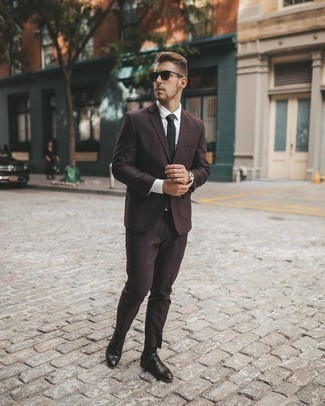 Burgundy Suit Outfits: Definitive proof that a burgundy suit and a white dress shirt look awesome when married together in a polished look for a modern man. Introduce a more laid-back touch to by rocking a pair of black leather derby shoes.
