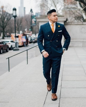 Orange Tie Outfits For Men: Consider pairing a navy suit with an orange tie for a really smart look. Show off your laid-back side by rounding off with brown leather derby shoes.