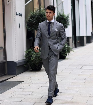Grey Suit Outfits: Wear a grey suit and a white and black vertical striped dress shirt - this look will certainly make ladies swoon. Complement this ensemble with a pair of navy canvas derby shoes et voila, your getup is complete.