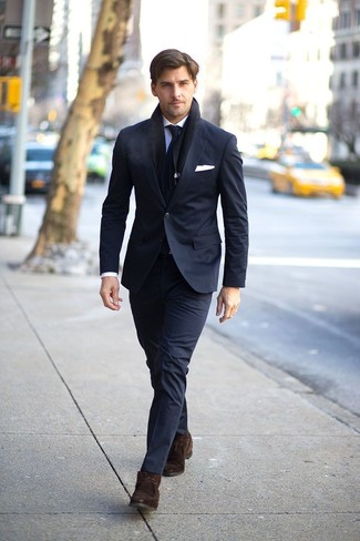 How to wear: black suit, light blue dress shirt, dark brown suede desert boots, black tie