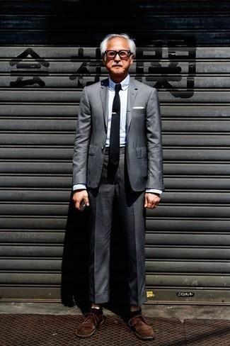 Fashion for Men Over 60: What To Wear: This pairing of a charcoal suit and a light blue dress shirt is perfect when you need to look incredibly stylish and polished. You could perhaps get a little creative with shoes and add a pair of dark brown suede desert boots to your outfit. As an older guy, you'll appreciate this getup.