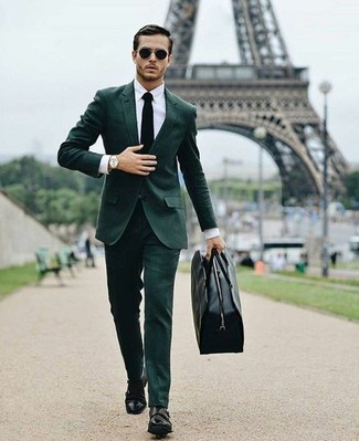 How to Wear a Dark Green Suit: Serve people a jaw-dropping look in a dark green suit and a white dress shirt. You can take a more casual approach with footwear and add a pair of black leather double monks to the mix.