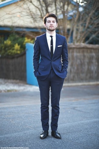 How to wear: navy suit, white dress shirt, black leather double monks, black tie