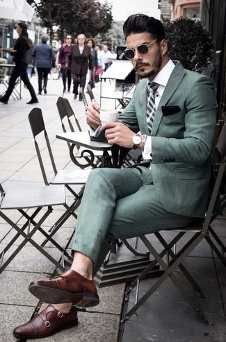 How to Wear a Mint Suit: A mint suit and a white dress shirt are essential in a versatile man's wardrobe. Brown leather double monks are a fail-safe way to give a dash of stylish casualness to this getup.