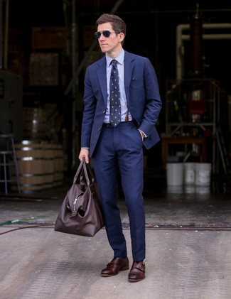 How to wear: navy suit, light blue dress shirt, dark brown leather double monks, dark brown leather duffle bag