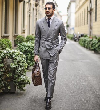 How to wear: grey vertical striped suit, white dress shirt, black leather double monks, brown leather briefcase