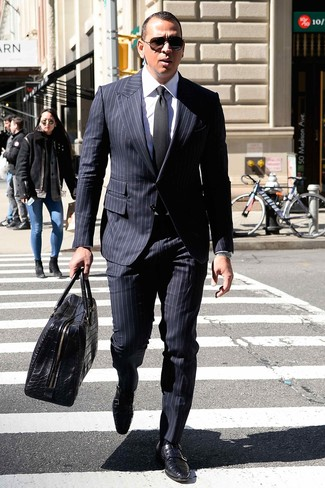 How to wear: navy vertical striped suit, white dress shirt, black leather double monks, black leather holdall