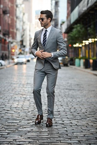 How to wear: grey plaid suit, white dress shirt, dark brown leather double monks, navy and white horizontal striped tie