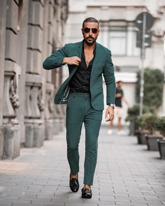 How to wear: dark green suit, black dress shirt, black leather double monks, dark brown sunglasses