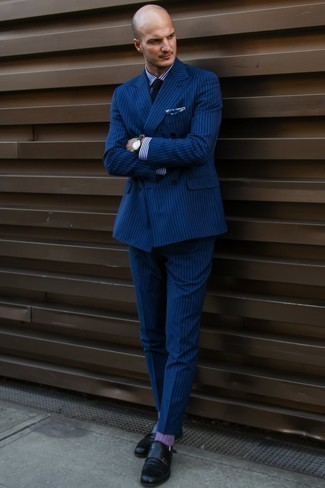 How to Wear Purple Socks For Men: Want to inject your menswear collection with some elegant dapperness? Consider pairing a navy vertical striped suit with purple socks. Feeling adventerous? Jazz up your look by wearing black leather double monks.