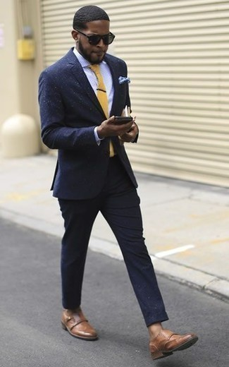 How to Wear Brown Leather Double Monks: You're looking at the solid proof that a navy suit and a light blue check dress shirt look amazing when paired together in a polished outfit for a modern gent. Complete your ensemble with brown leather double monks and the whole ensemble will come together.