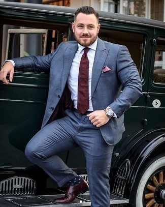 How to Wear a Blue Suit: For an ensemble that's nothing less than GQ-worthy, pair a blue suit with a white vertical striped dress shirt. Burgundy leather double monks pull the outfit together.