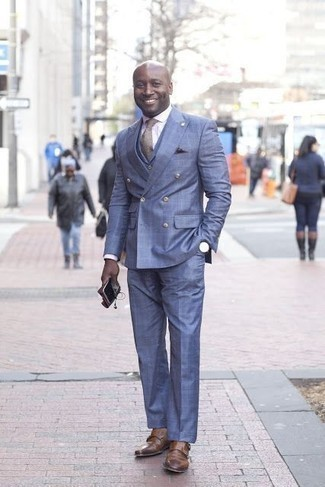 How to Wear a Blue Suit: This polished combination of a blue suit and a white dress shirt is a must-try ensemble for any gent. Go ahead and add brown leather double monks to the mix for a laid-back vibe.