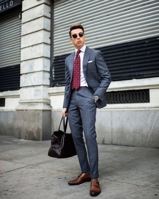 How to Wear a Burgundy Print Tie For Men: This ensemble suggests it is totally worth investing in such smart menswear pieces as a blue suit and a burgundy print tie. If you need to immediately play down this look with one piece, introduce a pair of brown leather double monks to the equation.