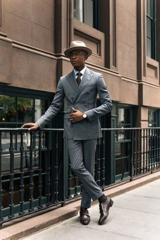 How to Wear a Suit: For a look that's absolutely GQ-worthy, reach for a suit and a white dress shirt. You can get a little creative on the shoe front and dial down this outfit by finishing with a pair of dark brown leather double monks.