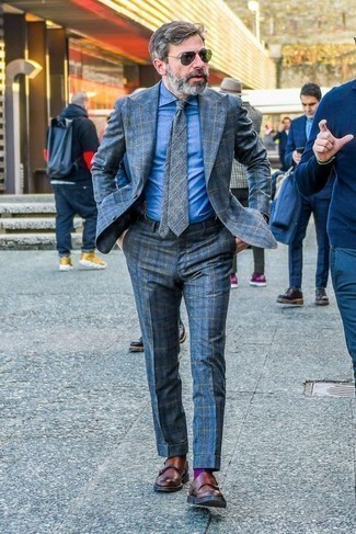 How to Wear Navy Suspenders: This pairing of a blue plaid suit and navy suspenders is effortless, dapper and very easy to imitate. You know how to breathe a dose of elegance into this ensemble: brown leather double monks.