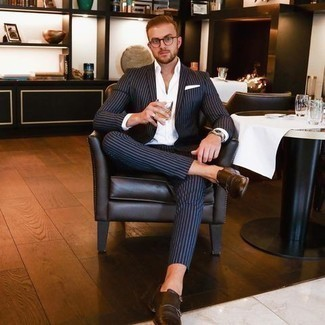 500+ Summer Outfits For Men: Choose a navy vertical striped suit and a white dress shirt for a stylish and refined look. Our favorite of a ton of ways to complete this look is with dark brown leather double monks. Stick with this one if you're scouting for a great summery ensemble.
