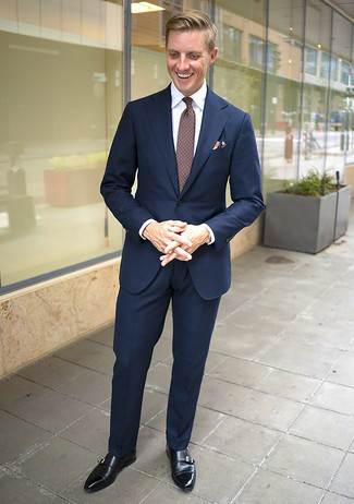 Tie Outfits For Men: For a look that's sophisticated and totally wow-worthy, marry a navy suit with a tie. If you want to instantly dress down this outfit with one item, throw a pair of black leather double monks into the mix.
