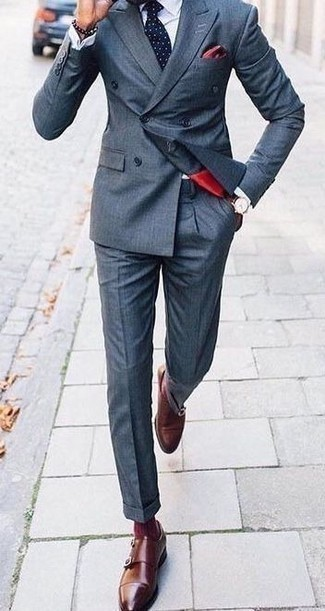 Navy Suit Outfits: Make a navy suit and a white dress shirt your outfit choice for sophisticated style with a modern finish. And if you want to instantly dial down your ensemble with a pair of shoes, why not introduce brown leather double monks to the equation?