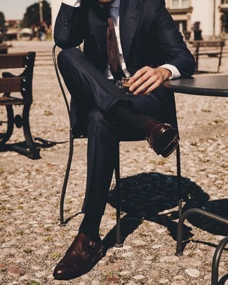 Dark Brown Leather Double Monks Outfits: A black suit and a grey print dress shirt are a good combination that will earn you a great deal of attention. Dark brown leather double monks finish off this getup quite well.