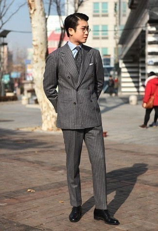 How to Wear Black Leather Dress Boots For Men: Putting together a charcoal vertical striped wool suit and a light blue vertical striped dress shirt is a fail-safe way to infuse style into your styling routine. Black leather dress boots are guaranteed to infuse an extra dose of sophistication into this outfit.