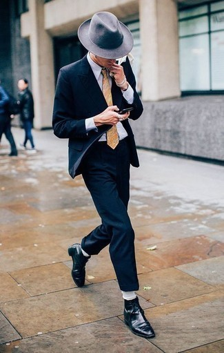 How to Wear a Beige Paisley Tie For Men: For a look that's nothing less than camera-worthy, make a navy suit and a beige paisley tie your outfit choice. To give your overall ensemble a more laid-back twist, why not add a pair of black leather dress boots to the mix?