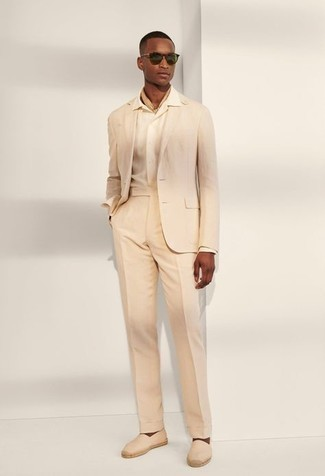 Beige Dress Shirt Outfits For Men: Loving how this pairing of a beige dress shirt and a beige suit immediately makes any man look refined and sharp. Complete this ensemble with beige canvas espadrilles to add a touch of stylish nonchalance to your ensemble.
