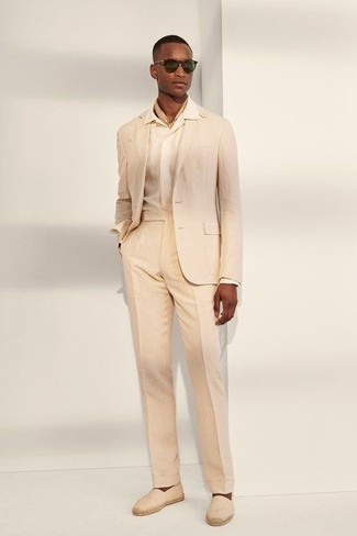 Beige Suit Outfits: Marrying a beige suit and a white dress shirt is a surefire way to infuse refinement into your current styling routine. Clueless about how to finish off? Complement this outfit with a pair of beige canvas espadrilles to switch things up.