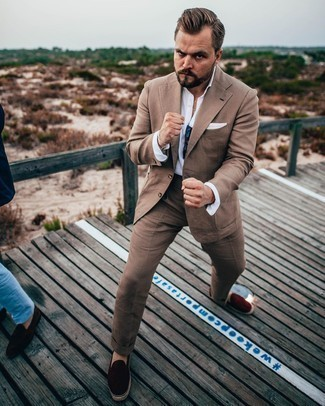Brown Suit Outfits: Combining a brown suit with a white dress shirt is a nice option for a classic and sophisticated ensemble. To give this look a more laid-back aesthetic, introduce a pair of burgundy suede espadrilles to the equation.