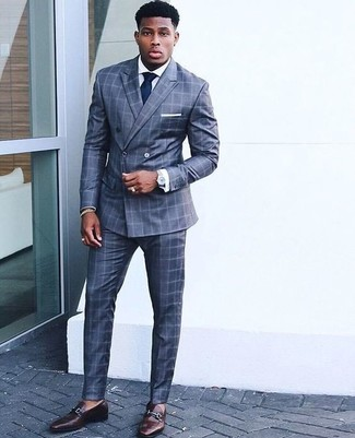 How to wear: blue check suit, white dress shirt, dark brown leather loafers, navy tie
