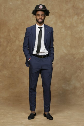 How to wear: navy suit, white dress shirt, black embellished leather loafers, black print baseball cap