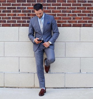 How to wear: blue suit, light blue dress shirt, brown leather loafers, light blue vertical striped tie
