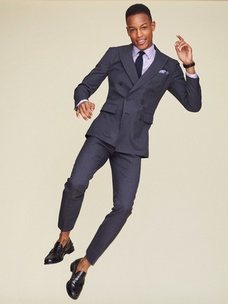 How to Wear a Suit: Putting together a suit with a light violet dress shirt is a good pick for a stylish and classy getup. Give a fun touch to your look with black leather loafers.