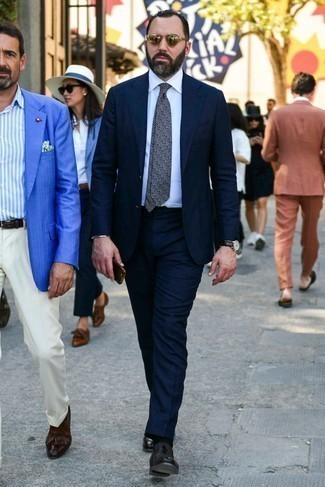 Navy and White Knit Tie Outfits For Men: You'll be amazed at how easy it is to get dressed this way. Just a navy suit and a navy and white knit tie. Burgundy leather loafers will bring a playful touch to an otherwise standard ensemble.