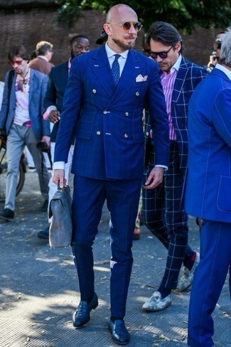 Men's Looks & Outfits: What To Wear In 2020: Solid proof that a blue plaid suit and a white dress shirt look awesome when worn together in a sophisticated getup for today's guy. Complete this look with a pair of navy leather loafers to have some fun with things.