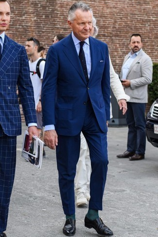 Men's Looks & Outfits: What To Wear In 2020: To look like a complete gentleman, opt for a navy suit and a light blue dress shirt. Introduce black leather loafers to your outfit to make the getup more current.