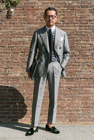How to Wear a Black Knit Tie For Men: This classy combo of a grey suit and a black knit tie is a common choice among the dapper men. And if you want to instantly tone down this look with one item, complement this getup with black velvet loafers.