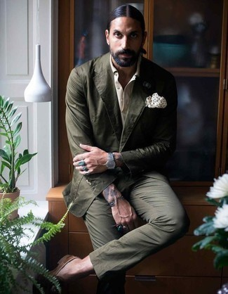 How to Wear a Dark Green Suit: Rock a dark green suit with a white dress shirt to exude elegance and polish. If you want to easily play down your ensemble with shoes, why not add a pair of brown suede loafers to the mix?