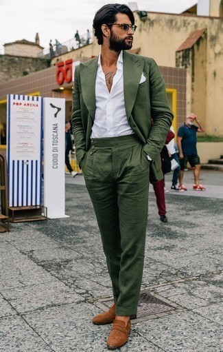 How to Wear Tobacco Suede Loafers For Men: This combo of a dark green suit and a white dress shirt embodies rugged refinement. Why not take a more laid-back approach with footwear and complement this ensemble with tobacco suede loafers?