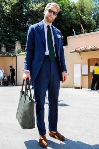 How to Wear an Olive Canvas Tote Bag For Men: This combo of a navy suit and an olive canvas tote bag is an obvious pick for when it's time to clock off. Tobacco suede loafers will give an extra touch of style to an otherwise straightforward ensemble.