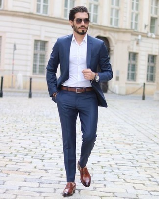 How to Wear a Brown Leather Bracelet For Men: A navy suit and a brown leather bracelet are a smart combo to have in your casual routine. Add tobacco leather loafers to the mix to completely shake up the look.