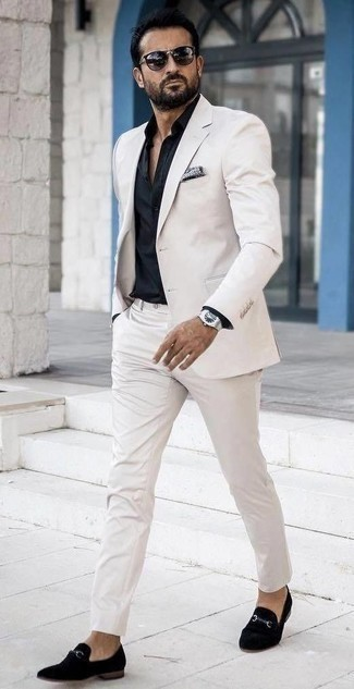 How to Wear a Black Dress Shirt For Men: Pairing a black dress shirt with a white suit is a nice choice for a sharp and sophisticated outfit. You could take a more casual route when it comes to shoes by sporting a pair of black velvet loafers.