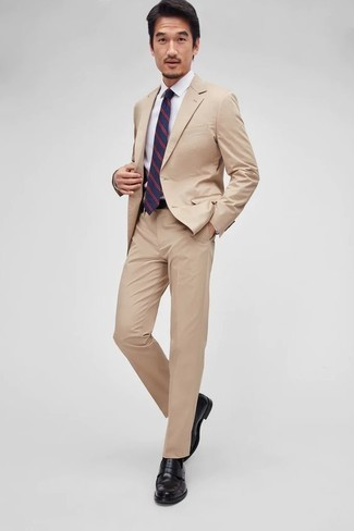 How to Wear a Tan Suit: A tan suit and a white dress shirt are among the fundamental elements of a elegant menswear collection. To give this ensemble a more casual aesthetic, why not add black leather loafers to this ensemble?