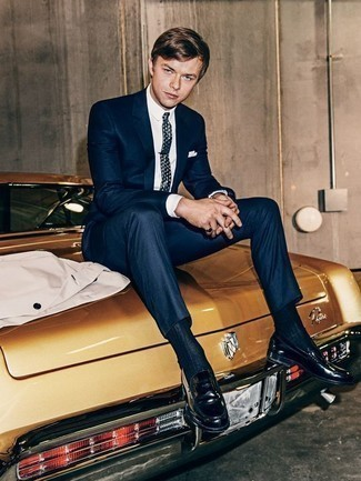 How to Wear Navy Leather Loafers For Men: A navy suit and a white dress shirt are an elegant ensemble that every modern gentleman should have in his wardrobe. Feeling adventerous today? Tone down your getup by slipping into a pair of navy leather loafers.