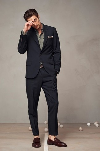 How To Wear a Black Suit With Brown Shoes: This combination of a black suit and an olive dress shirt is the picture of manly refinement. Amp up this outfit by wearing brown fringe leather loafers.