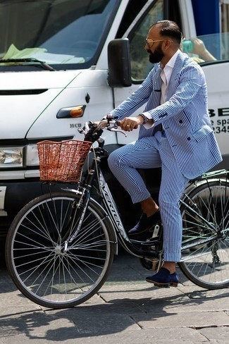 How to Wear a Blue Vertical Striped Suit: The sartorial collection of any gentleman should always include such essentials as a blue vertical striped suit and a white dress shirt. Does this getup feel all-too-perfect? Let a pair of navy suede loafers shake things up.